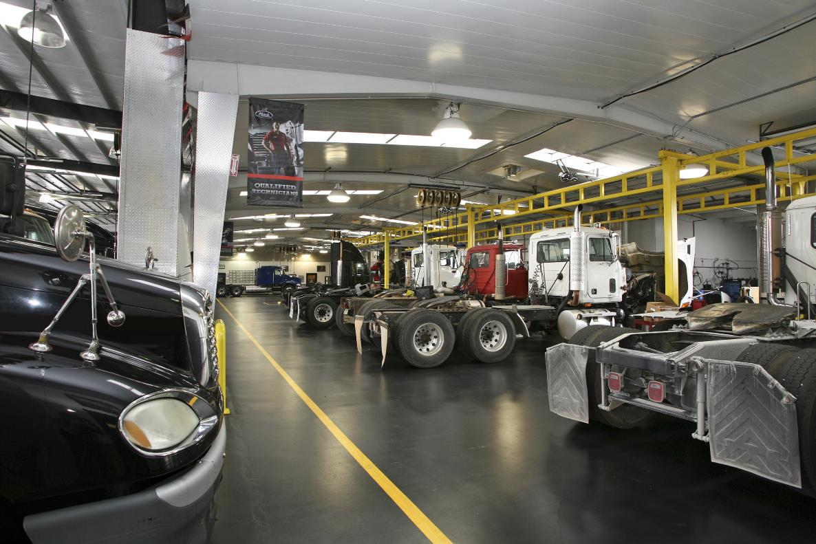 Trucks in service bay
